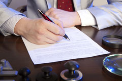 Notary signs the documents from our office Stock Photos