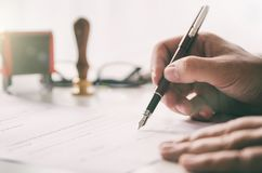 Notary signs legal contract. Businessman working in office royalty free stock photos