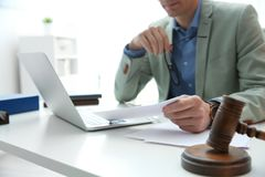 Notary working at table in office, closeup. Law and justice. Concept royalty free stock photo