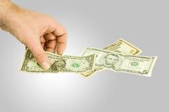 notas доллара выбирая вверх Стоковое Фото