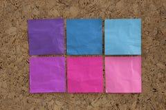 Notas azules, rosadas, magentas del recordatorio Imagen de archivo libre de regalías