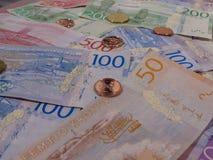 Notas da coroa sueca e moedas, Suécia Foto de Stock
