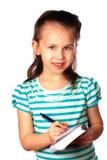 Notas da escrita da menina Fotografia de Stock Royalty Free