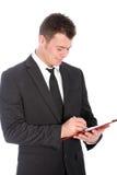 Notas da escrita do homem de negócios em uma prancheta Imagem de Stock Royalty Free