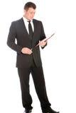Notas da leitura do homem de negócios em uma prancheta Fotos de Stock