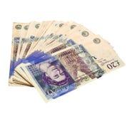 notas de 20 libras espalhadas - trajeto de grampeamento Fotos de Stock