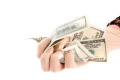 Notas de banco dos dólares da terra arrendada da mão Imagem de Stock