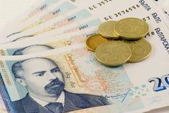 Notas de banco e moedas Fotografia de Stock Royalty Free