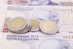 Notas de banco e moedas de Argentina Imagem de Stock Royalty Free
