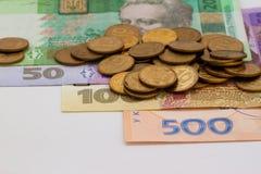 Notas de banco e moedas ucranianas Fotografia de Stock