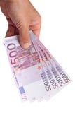 Notas de banco em sua mão Fotografia de Stock Royalty Free