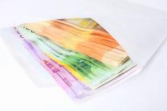 Notas de banco em um envelope Imagens de Stock Royalty Free