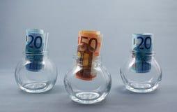 Notas de banco em uns frascos Foto de Stock Royalty Free