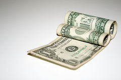 Notas de banco roladas do dólar Fotos de Stock Royalty Free