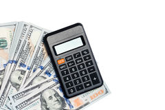 100 notas de dólar e calculadoras Fotografia de Stock