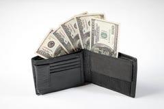 Notas de dólar em uma carteira dos homens negros em um fundo branco e em um passaporte da Federação Russa imagens de stock royalty free