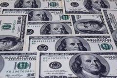 Notas de dólar organizadas fotografia de stock