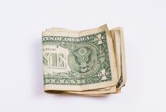 Notas de dólar uma dobradas na moeda americana Fotografia de Stock