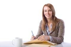 Notas de la escritura de la mujer de negocios en el escritorio Fotografía de archivo libre de regalías