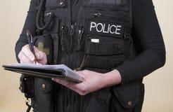 Notas de la escritura del oficial de policía Foto de archivo