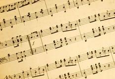 Notas de la hoja de música de la vendimia. Fotos de archivo