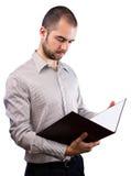 Notas de la lectura del hombre de negocios Imágenes de archivo libres de regalías