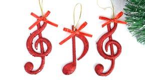 Notas de la música, escena de la Navidad, decoración Imágenes de archivo libres de regalías