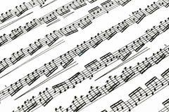 Notas de la música sobre el papel Foto de archivo libre de regalías