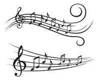 Notas de la música sobre bastón Fotos de archivo