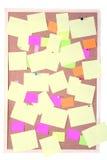 Notas de papel sobre el sujetapapeles fotos de archivo