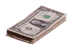 Notas de um dólar empilhadas Fotos de Stock