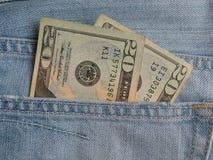Notas de USD en bolsillo de los tejanos Foto de archivo