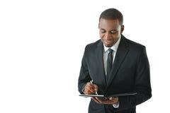 Notas de Writing do homem de negócios Imagem de Stock
