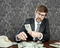 Notas del dólar del contable del empollón del hombre de negocios Fotografía de archivo libre de regalías