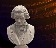 Notas do busto e da música de Beethoven fotografia de stock