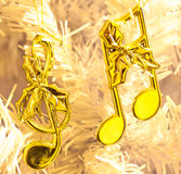 Notas douradas da música do Natal Fotos de Stock
