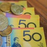 Notas e moedas do dinheiro Fotografia de Stock