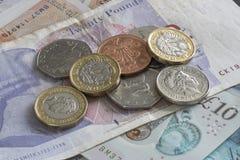 Notas e mudança inglesas do dinheiro Fotografia de Stock Royalty Free