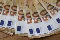 Notas euro con la reflexión Fotografía de archivo libre de regalías