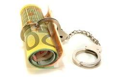Notas euro con las manillas fotos de archivo