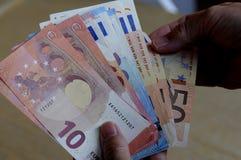 Notas euro de la moneda Fotos de archivo
