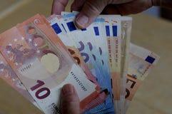 Notas euro de la moneda Imágenes de archivo libres de regalías