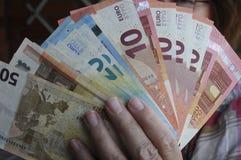 Notas euro de la moneda Foto de archivo libre de regalías