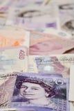 Notas inglesas de la libra del fondo del dinero Fotos de archivo libres de regalías