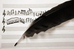 Notas musicais e pena Foto de Stock Royalty Free
