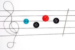 Notas musicais no bordado Fotografia de Stock Royalty Free
