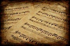 Notas musicais no pergaminho Imagens de Stock Royalty Free