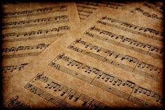 Notas musicais no pergaminho Foto de Stock Royalty Free