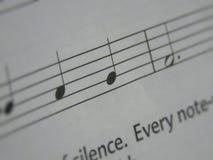 Notas musicales básicas con un poco de texto Imagenes de archivo