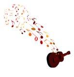 Notas musicales y guitarra Fotografía de archivo libre de regalías
